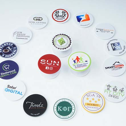 "More and more companies are adopting custom popsockets for brand promotion. Custom popsockets has been the most acceptable way when talking about your brand market in a unique way. Popsocket is a collapsible phone stand, which helps you grip you phone more secure and comfortable. By using a pop phone grip, you can text with one hand, take a selfie easily. More and more pop sockets are sticked on the back of people's cell phone. Imagine this, if your brand logo is shown on the back of these cellphone, you would get thousands of ""mobile"" advertising board in this city! Compared with other types of promotional campaign strategies such as TV or radio ads, Popsocket custom service definitely cost way cheaper, yet the marketing approach is subtle yet powerful. These wholesale popsockets are customizable, all you need to do is send us your brand logo, and we will design and print for you. With a creative image design, consumers will not hesitate to stick your logo popsockets on their phone back anywhere they go, hence giving your business more brand visibility. We are a factory direct supplier online to offer cheap custom popsockets service. We service an expanding client list on a budget, on time and on specification. Any requirement please feel free to let us know, we will response immediately."
